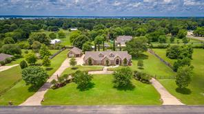 Located in the gated subdivision of Outpost Cove Estates, this beautiful home is situated on 1.6 acres.