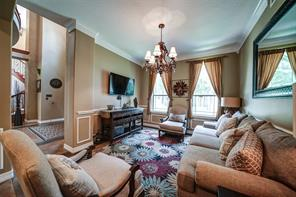 The current owner likes to use the formal dining as a formal living area. It is a flexible room with crown molding and space for large furniture, if you have a big table, buffet and chairs.
