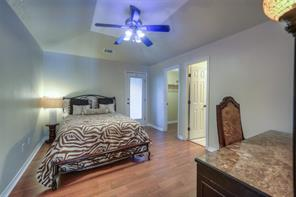 Guest suite has a walk-in closet and full bathroom. Also, a doorway to the enclosed balcony.