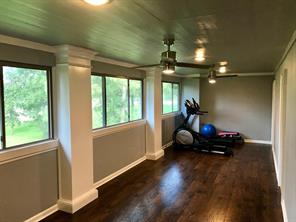 Another view of the finished balcony. Newer ceiling fans and slider windows in this room.