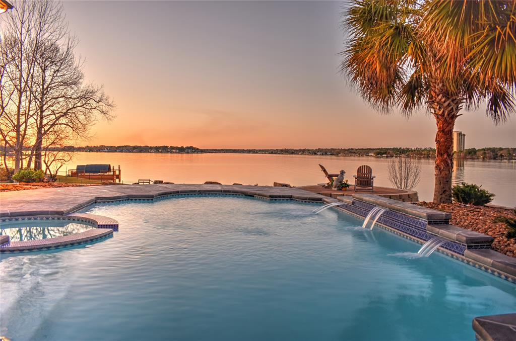 Stunning Lake Conroe WATERFRONT home with OPEN WATER VIEWS! 2-Story Stucco home with screened porch and balcony.  The back faces NORTH, the preferred direction to limit the afternoon sun.  PANORAMIC  VIEWS from almost every room with butted glass throughout. Grand owners retreat with wood flooring, dual vanities, huge closet with built in cabinetry. Welcoming living and dining area with separate study.  Dream kitchen with built in fridge, gas cooktop, tons of cabinet space, walk in pantry and oversized utility area.  The upstairs game room with wet bar has an incredible view and access to a screened balcony.  Three large bedrooms and two baths finish the space upstairs. The .65 acre lot has producing pecan trees, beautiful landscaping and a newly refinished pool and patio area. The Cliffs at South Shore is a gated waterfront community on the southern shore of Lake Conroe, convenient commute to The Woodlands, close to dining and shopping options and zoned to Montgomery ISD!