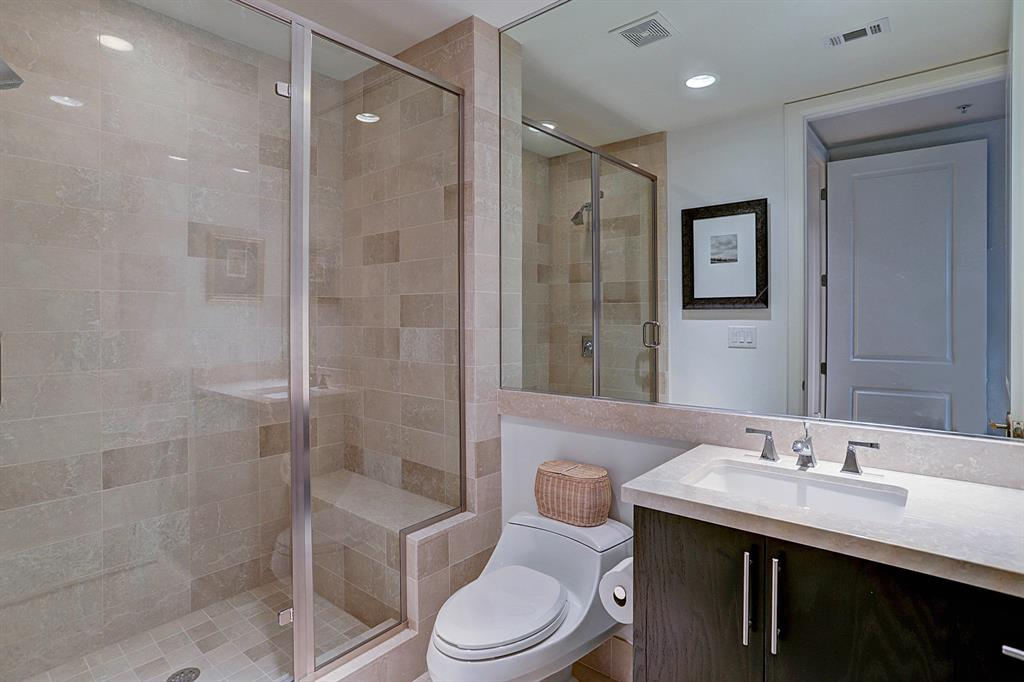Your guests will love the elegant guest bathroom, beautifully tiled oversized shower.