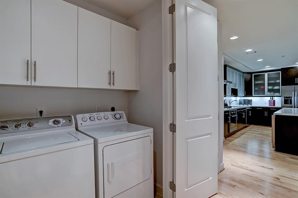 Full size washer / dryer remain with the unit.   Plenty of cabinet space for storage and conveniently and discreetly located in the hallway, behind beautiful wood doors.