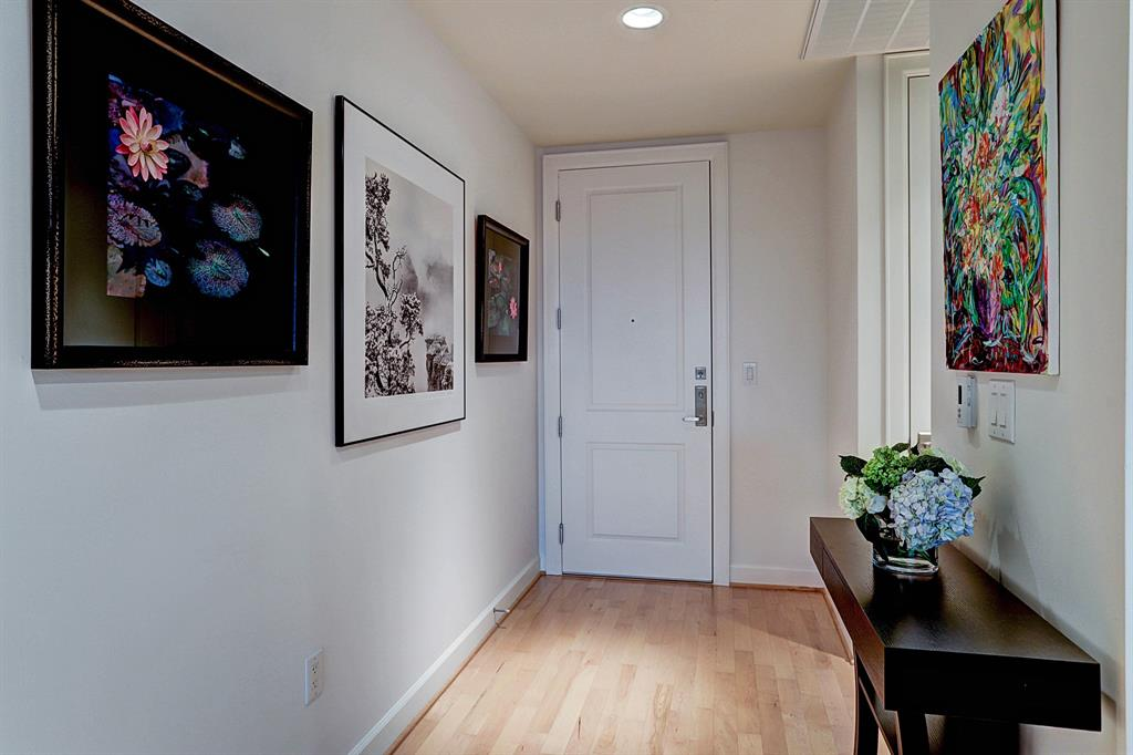 Another view of the entry way, with ample wall space to display your art!