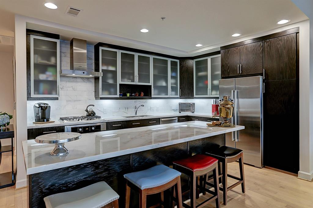 Stunning Carrara marble enhances the large kitchen island - enough counter space for the most discriminate chef!  Stainless steel appliances and gas stove top.