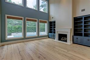 Overlooking the FORMAL LIVING ROOM is a wide 2nd floor BALCONY with graceful metal balusters and oak railings.