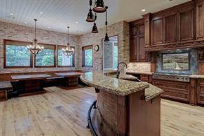 The very spacious GOURMET KITCHEN, BREAKFAST ROOM & FAMILY ROOM.  This is a perfect view of the reclaimed Old Chicago brick surround and the reclaimed white oak flooring from Connecticut.