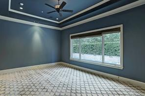 The BUTLER'S PANTRY is next to the FORMAL DINING ROOM and provides a wide counter for buffet serving.  A very spacious PANTRY is beyond the closed door on the right.  The entry into the GARAGE is through the door on the left.