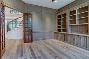 Another view of the EXECUTIVE STUDY & LIBRARY highlights several windows that bathe this room in natural light and frame the Front Yard.  Notice all of the shelving for books and displaying treasures.