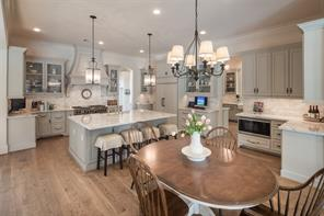 The generously sized kitchen and breakfast area yields a spacious living area ideal for gathering of friends and family.