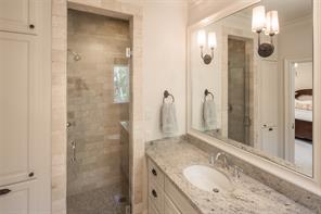 Secondary bath has limestone Salem gray flooring, Kashmir cream granite countertop, and Crema Marfil marble subway tile surround shower with seating.