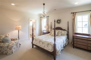 Gorgeous sun-lit south facing bedroom with recessed lighting, crown molding, extended baseboards and lush carpeting and Rococo Iron and crystal chandelier.
