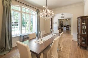 Easy French farmhouse elegance comes to mind in the exquisite view-filled dining room.  11' ceiling empowered by a stunning Rococo iron and crystal chandelier.