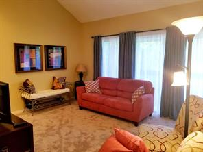 Nice, open living area with great furniture and decor, new carpet and balcony view.