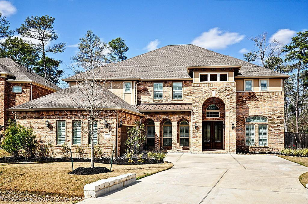 Formal living and study flank foyer with formal dining just off kitchen. Large island kitchen with breakfast area open to family room with corner fire place. Large master suite with his & hers walk in closets. Custom hidden playroom beneath stairs. Extra garage storage space. Upstairs game room features a wet bar. Media room. French doors lead to covered balcony across back of house.  Large back patio without any neighbors to see!  View is of Nature Preserve. Pool, spa & firepit
