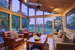 The Living Room (13 X 11) juts out from the Family Room and provides three windowed walls for viewing the outdoors. The sky light also provides for an even greater amount of light to enter this special room  Spot lighting, celing fan, pitched ceiling further accent the space.
