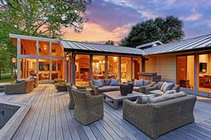 A wrap around elevated Porch provides several outdoor sitting areas just outside the living/dining area and the master bedroom.