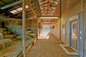 The Stables are just a short walk from the two houses and include eight generously sized stalls.  The building also includes a two bedroom apartment with living/dining/kitchenette.