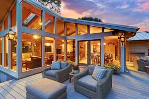Another view of the wrap-around Porch allowing for several sitting areas to enjoy the outdoors.