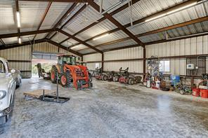 The Equipment Barn is spacious in size (59 X 39) to accommodate all the needed machinery for the maintenance and upkeep of the estate.