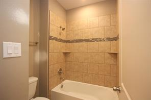 Tub/shower area of full bath has a door for privacy from the vanity area.