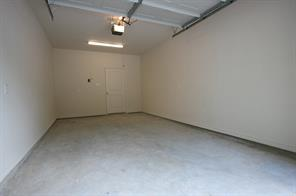 One car garage is 12X20' and has an automatic opener and extra light added.