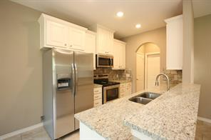 Kitchen in unit A has the same layout and colors as unit B, and is the same size.