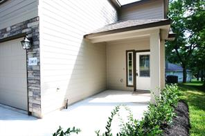Closer look at the covered front porch entry.