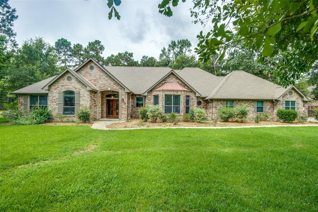Beautiful Benders Landing home sitting on over an acre. It features a wide open floor plan with a huge kitchen, recently updated formal dining room and family room. Beautifully done breakfast bar with granite and spacious breakfast room. Stunning craftsmanship throughout the home and designed with lots of storage. A special multi purpose room with it's own private on-suite could be a game/craft room or private bedroom for your guests. The master on-suite is laid out perfectly with a massive closet and built ins with a whirlpool tub and large shower. Private back patio leads to a yard with a mix of huge trees and tastefully done landscaping. Lots of room for your toys in the 3-car garage w/ample parking outside. Don't miss this opportunity for a move-in ready property