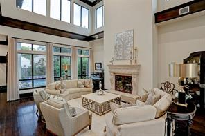 This FAMILY ROOM has a vaulted ceiling and is bathed in natural light from lower and upper windows.  Notice all of the wall space for large-scale artwork!
