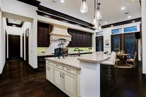The GOURMET KITCHEN with a large walk-in Pantry and the Elevator down the hallway on the left.  The Breakfast Room is on the right.