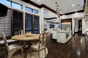 A closer look at the BREAKFAST ROOM.  Notice the handsome wood shutters over the windows.