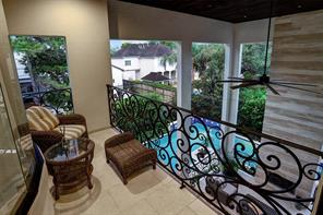 Another view of the BALCONY overlooking the heated pool and two-story covered BACK PORCH.