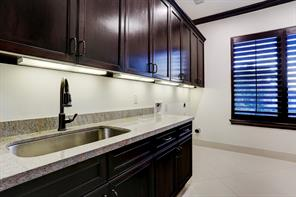 2nd Floor LAUNDRY ROOM with a large sink and exceptional storage.