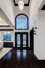 The gracious FOYER with Study on one side and the Formal Dining Room on the other side.  Notice the gleaming wood floors and all of the natural light.
