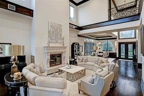 The FAMILY ROOM is a large open area with a gas log fireplace with decorative mantel and surround.