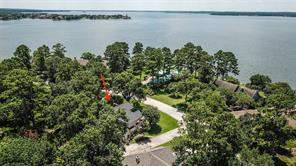 Aerial view of the home shows the proximity of the home to the lake. There are lake views from almost every room in the front of this home!