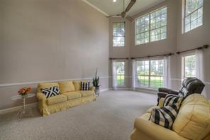 Spacious two-story living room with views of Lake Conroe!