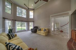 Another view of the living room just off of the entry foyer; lots of natural light in this room!