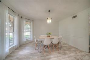 Formal dining room with views of Lake Conroe! New vinyl wood plank flooring in this room adds warmth.