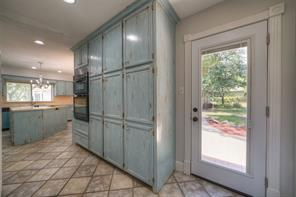 Tons of storage in this kitchen! Door in this area leads to the back yard.