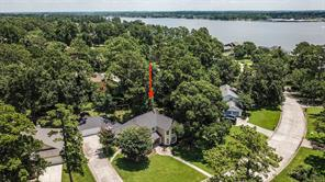 Aerial view of home shows the mature shade trees throughout the neighborhood. The lake is just across the street.