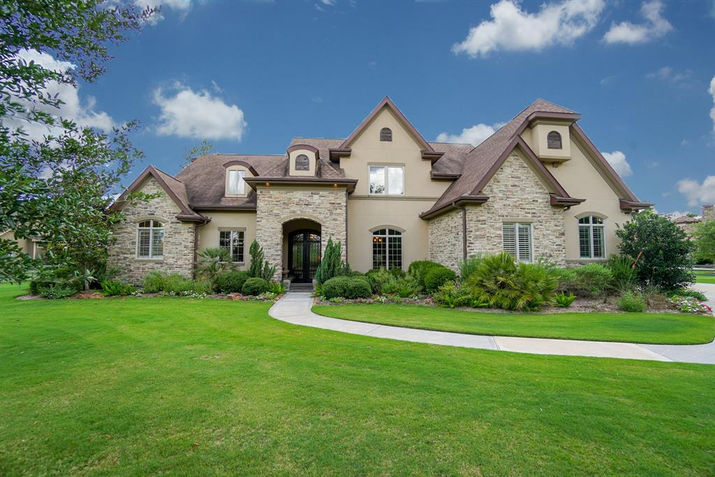 Gorgeous custom 2 story 4/4.5/3 stone home. Approx 4864 Sq Ft. Double wood & glass front doors w/ wrought iron detail. Raised media or second study, butlers pantry, wine room w/ chiller, study. Kitchen open to family, double wet islands, Bosch 5 burner gas range & double convection ovens, Monogram fridge, two dishwashers, GE microwave. Surround in fam, kit, din, med and patio. Mud rm w/wood locker space. Large utility w/ lots of cabinets, workspace & large closet to add freezer. Master suite w/ added room could be nursery, sep sitting, or gym. Spa like bath & walk in wardrobe. Full house generator. Upstairs features two beds, 2 baths, workstation, gamerm & bonus room (could be secondary media or gym). Sparkling pool w/ jacuzzi & waterfall, covered lanai w/ cathedral ceiling, outdoor fp & summer kit. Fruit trees.Zoned w/ 3 units. Well. 3 car garage w/ sink, built ins & 220 volt plug. Sprinkler system. Electric gate with call box. Quiet culdesac street. Reserve behind for added privacy!