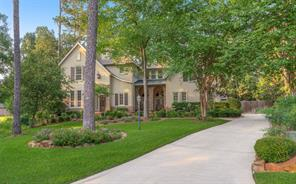 Luxurious custom home in gated Bentwater. Impressive drive up with professional landscaping and cast stone accents.