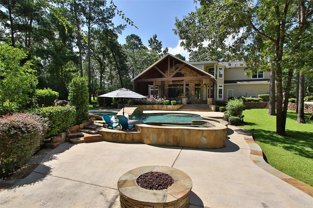 "Wow! This home has it all along with the most fabulous outdoor living and entertaining. 6 car garage! Quest quarters/ office above 3 car garage w/ private entrance has 2 full offices plus main room kitchenette area & half bath! Too much to describe! Photos have additional info! This approx 4 acre lot has 2/3 acre stocked pond w/ lighted fountain, Zip line & ladder for easy water access! Water Well 3 HP pump/motor unit w/ holding tank sized for maintaining water levels in pond + irrigation! 50X30 Workshop w/ 50X15 overhang & pull through for RV/Boats! Backyard has amazing POOL/SPA approx 40K gal, w/ water falls, bridge, tanning area w/umbrella & seating area! bubblers +LED lighting,2 fire pits, stunning outdoor kitchen set up for any type of parties & entertaining! Mosquito sys! Inside home: master bath won 2nd place in 2015 bathroom remodels for Greater Houston area! Media room is to die for! Soundproofing, bar area w/ mini frig , 140"" screen +amazing audio systems(extensive). +MORE!!!"