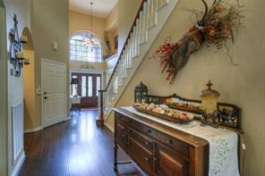 Two story foyer graced with arches and art nooks creating an impressive entrance