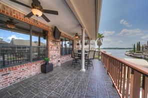 Gorgeous view of Lake Conroe from this covered back patio.