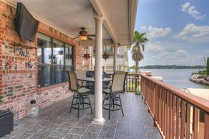 Sit back, relax and enjoy a football game on this large covered back patio.
