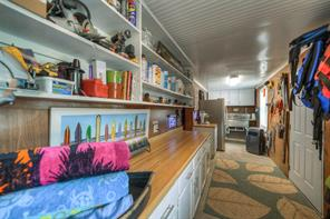 Full size refrigerator, microwave, commercial sink, new cabinets, bar, work bench, plenty of storage and exercise/tornado/hurricane safe room make for a one-of-a-kind man cave on the lake.