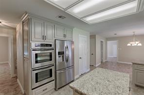 His and Her ovens, French Door Refrigerator and Island are all pluses in your executive kitchen.